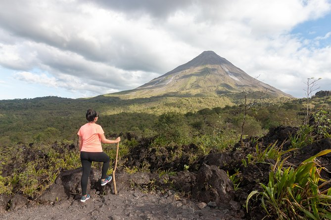 4-in-1 Arenal Volcano Tour: Hanging Bridges, La Fortuna Waterfall, Volcano Hike, and Tabacon Hot Springs