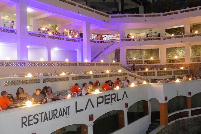 High Cliff Divers Show of La Quebrada at La Perla Restaurant