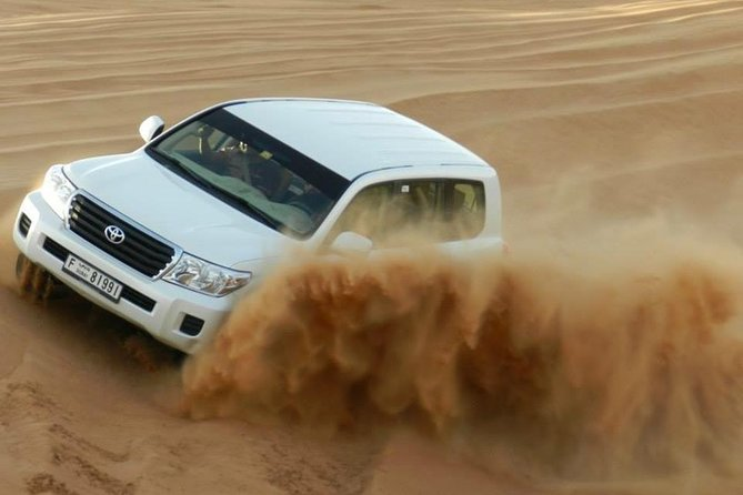 Private Evening 4x4 Dune Bashing With Camel Ride and Sand boarding