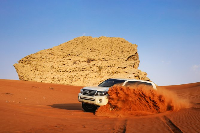 Fossil Rock Red Dunes Safari with Camel Ride & BBQ