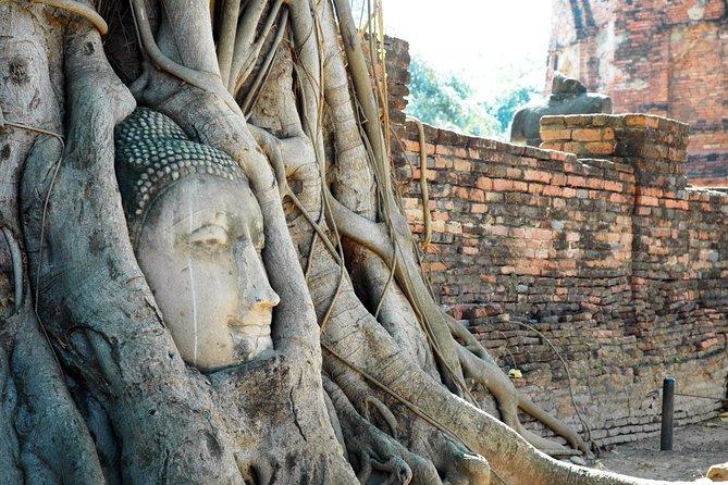 Explore the ancient capital of Ayutthaya by tuk-tuk
