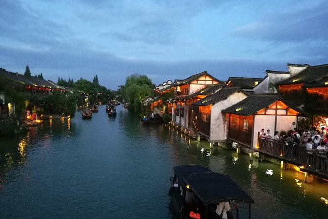 Wuzhen Water Village Sunset Tour with Riverside Dining Experience from Hangzhou