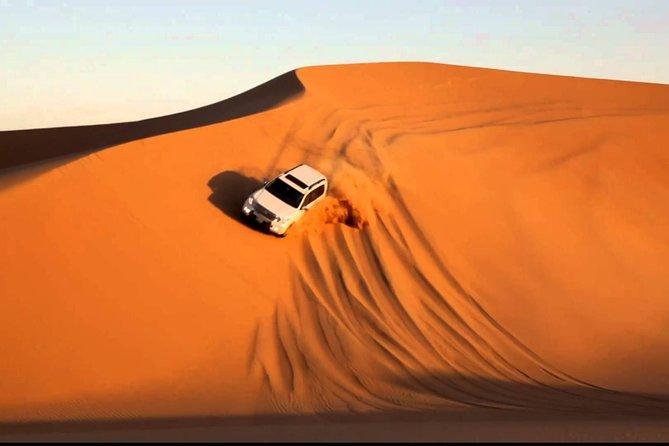 Abu Dhabi Desert Safari 4x4 Dune Bashing & Camel Riding & Sand Boarding with BBQ