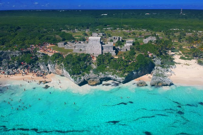 Excursión a las ruinas de Tulum, buceo de superficie en cenote maya, tirolina, recorrido en camioneta campo a través