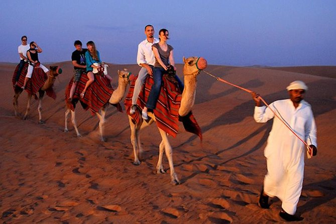 Desert Experience: Dinner and Emirati Activities ,Camel Ride Sand Board ATV Ride photo 11
