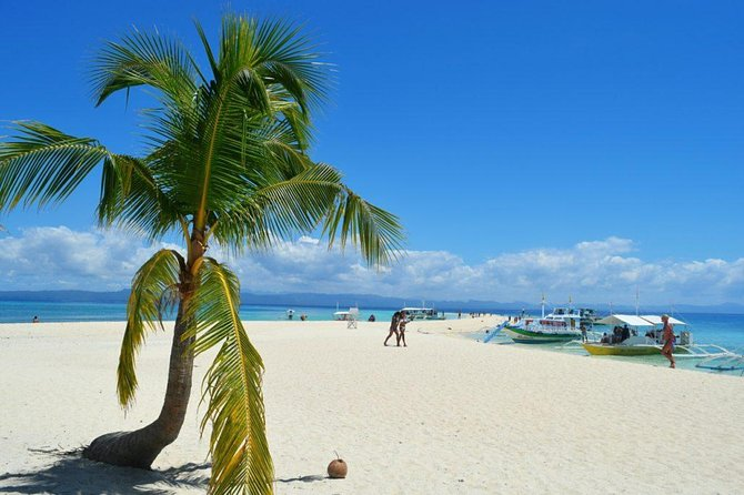 Kalanggaman & Malapascua Island Day Tour with Private Transportation