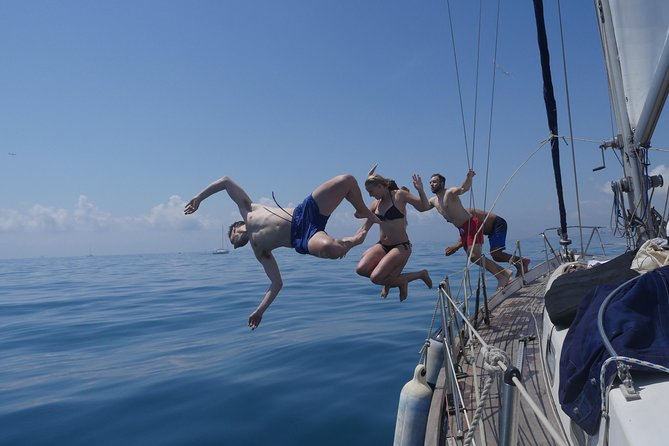 Open group sailing and swimming tour in Barcelona