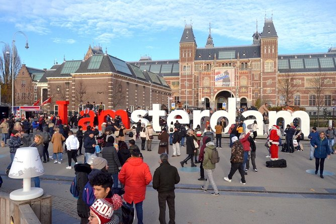 Amsterdam in a Nutshell 4 Hour Private Car Tour and Amsterdam Born Private Guide