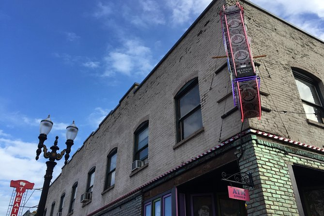 Walking past the world-famous Voodoo Doughnut -- and discovering what makes them so popular (hint: this building used to be a club!) on our Weird Portlandia tour (4 pm departure)
