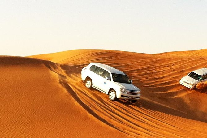Premium Desert Safari, Barbeque, 3 Shows, Camel ride, Sand-board at Bedouin camp