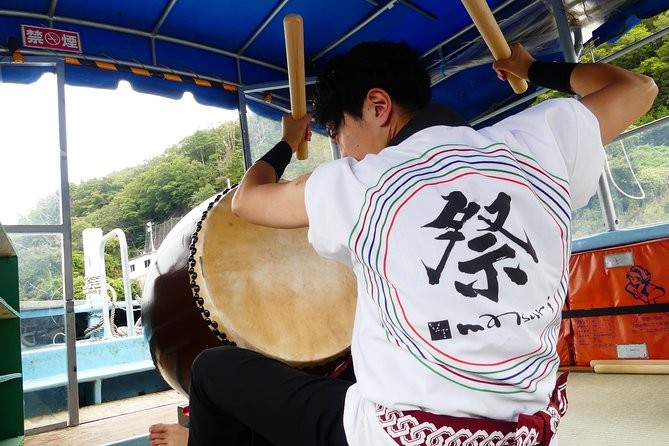 Traditional Japanese Drum Performance On Board A Boat photo 3