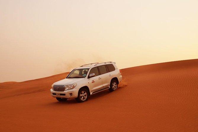 Dubai Desert Safari: BBQ, Camel Ride & Sandboarding