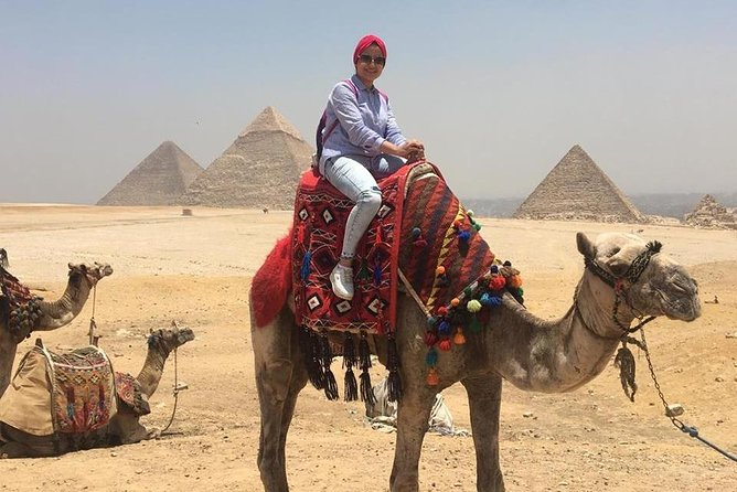 A private Tour of Giza Pyramids, Memphis & Saqqara ( All Inclusive ) Camel ride