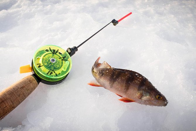 Ice Fishing On The Frozen Lake Or River