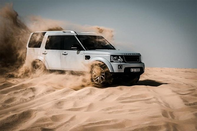 Desert Safari with Dune Bashing, Camel Ride & BBQ Dinner