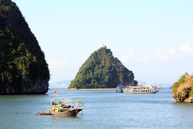 Halong Bay Cruise Day Trip: Titop island, Surprise cave, Swimming, Kayaking