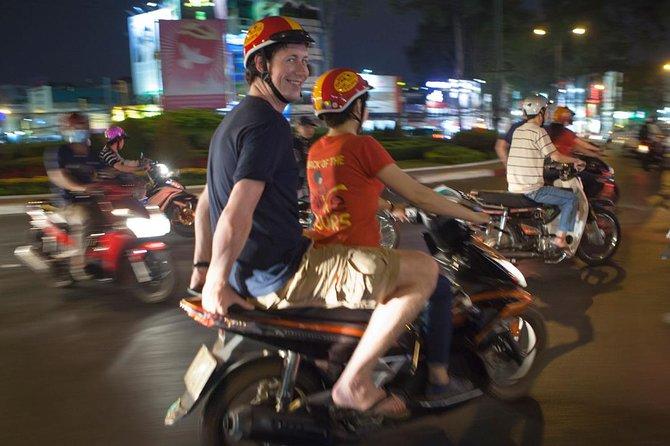 Saigon Sunset Cruise and Motorbike Foody Tour