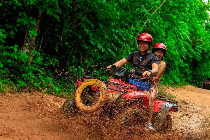Drive an Atv in the jungle, do ziplines and swim in a Cenote from Cancun