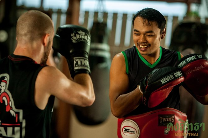 Muay Thai Lesson Led by Boxing Champion with Pad Thai photo 11