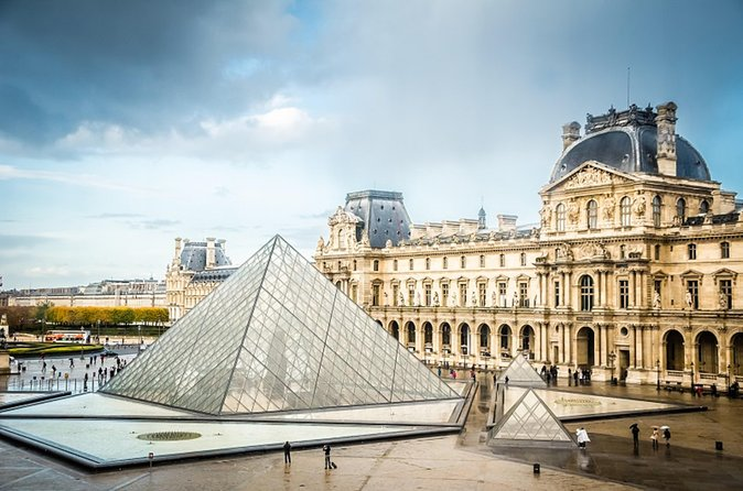 Paris Sightseeing from Disneyland with Skip-the-Line Louvre Audio Guide Tour photo 1