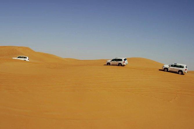 Morning Dubai Red Dunes Safari With Camel Ride & Sand boarding