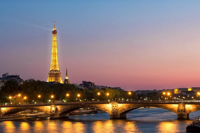 Paris By Night with Seine River Cruise and Roundtrip Luxury Transportation