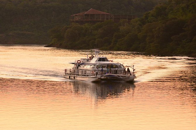 Catamaran on Iguazú and Paraná rivers by sunset photo 1