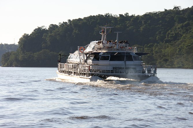 Catamaran on Iguazú and Paraná rivers by sunset photo 2
