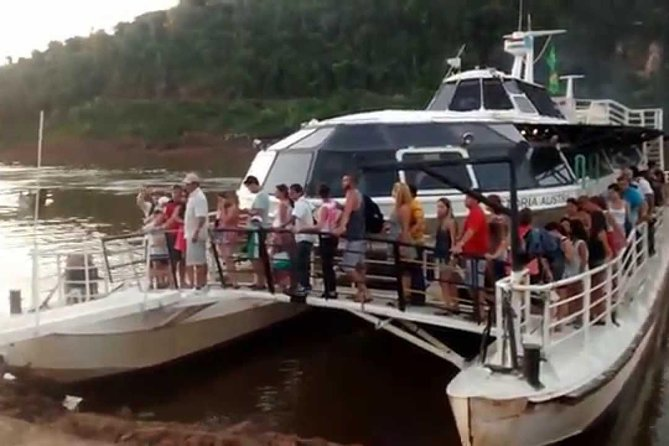 Catamaran on Iguazú and Paraná rivers by sunset photo 3