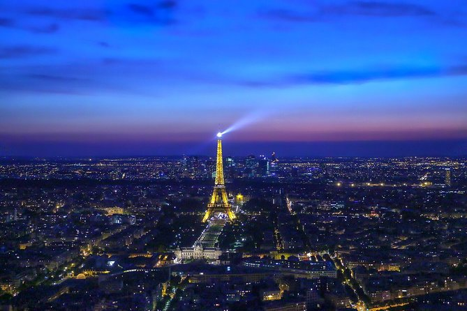 Eiffel's Glittering Tower's Summit by Night