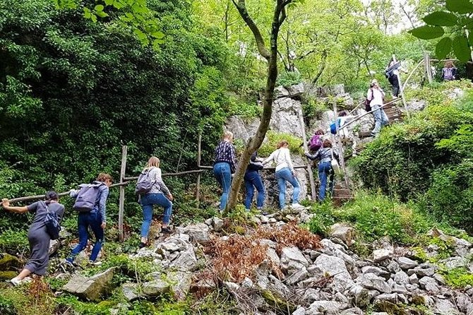 Climb the stone wall to reach the WWI military village