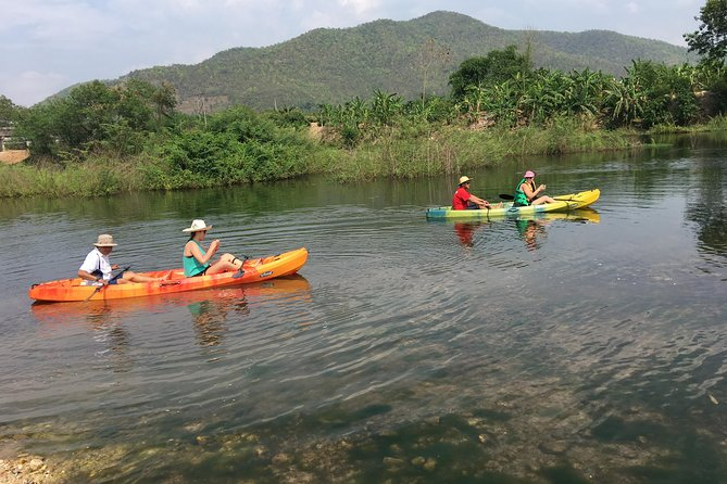 Kayaking plus Amazing Green temple and Sticky waterfalls