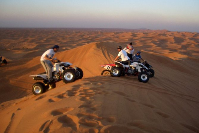 Dubai Red Dunes Safari by Quad Bike, Sand boarding, Camel Ride & BBQ Dinner photo 2