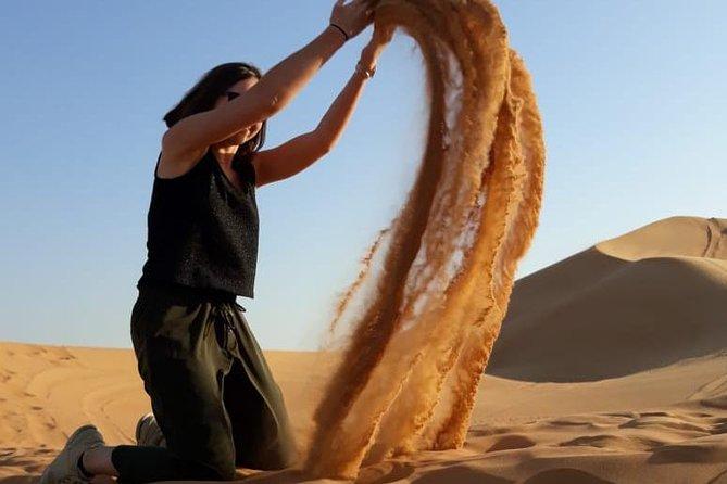 Dubai Morning Safari: Red Dunes, Camel Ride and Sand boarding