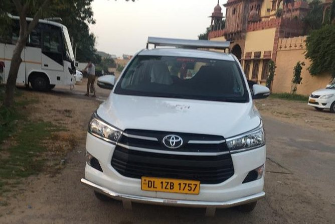Delhi Airport or Hotel to Jaipur Transfer with Air Conditioned Car and driver