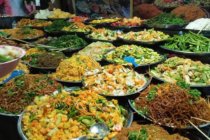 Luang Prabang Sightseeing & Vegetarian Food Tour by Vintage Tuk Tuk