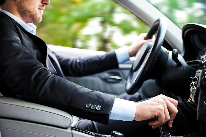 Chauffeured Airport Transfer to/from or Sea-Tac International Airport - One Way