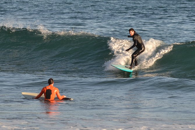 LEARN TO SURF: A Surf Lesson with hotel pick up and a passionate surf instructor