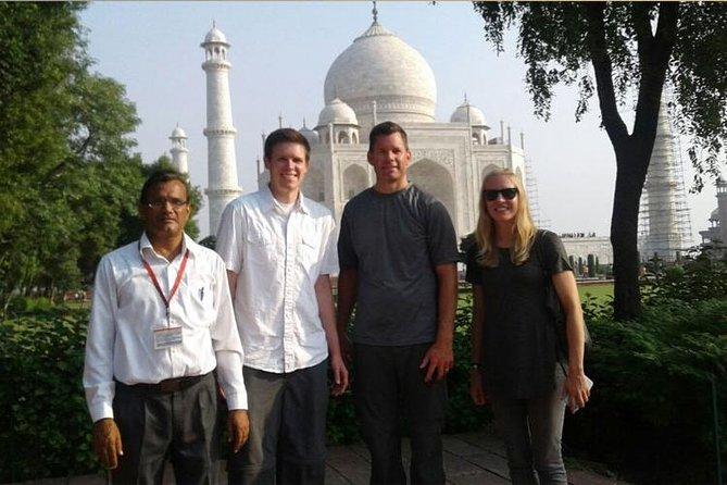 Book Guide for Taj Mahal & Fort.