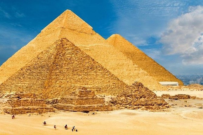Pyramids of Giza and riding camel, from Suez