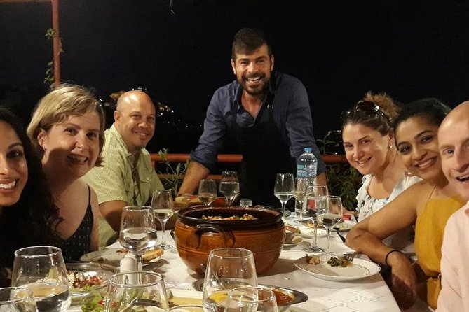 Greek dinner on a luxury terrace rooftop with view of the Acropolis