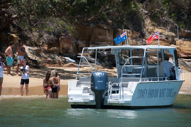 Sydney Harbour Boat Tour with Unique Beach Landings and Local Guide
