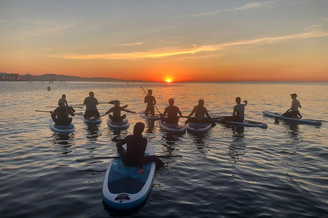 Stand up paddle during wonderful sunset in Valencia photo 2