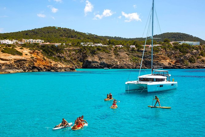 Cala Comte and Cala Bassa Cruise with Paddle Surf, Snorkel and Drinks