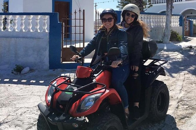 Cruise through the magical villages of Santorini on our ATVs, Scooters, or Cars photo 2