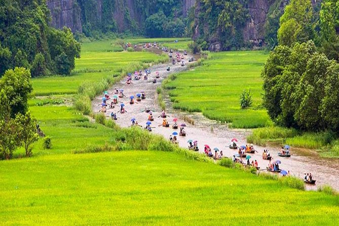 Hoa Lu Tam Coc Full-Day DELUXE Tour Including BUFFET LUNCH & River Boat Ride photo 12