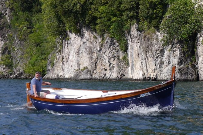 Slow boat tour for small groups with appetizer on Lake Maggiore