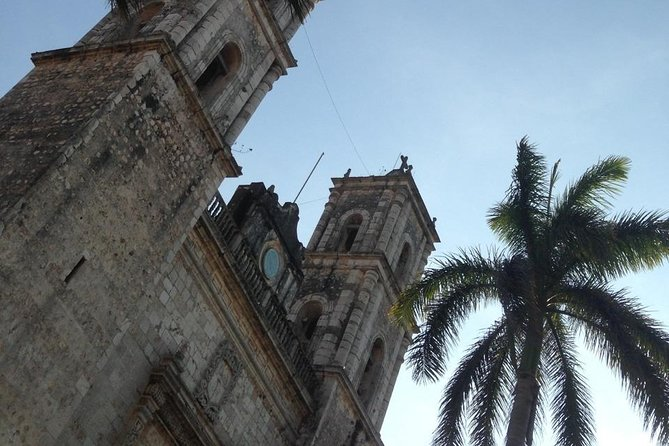 Discover Chichen Itza with Round Trip, Buffet, Cenote Swim and Valladolid Tour