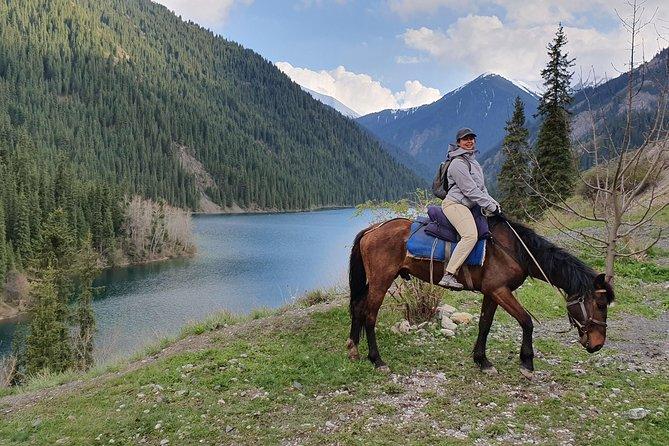 Horse riding adventure through Kolsay Lakes