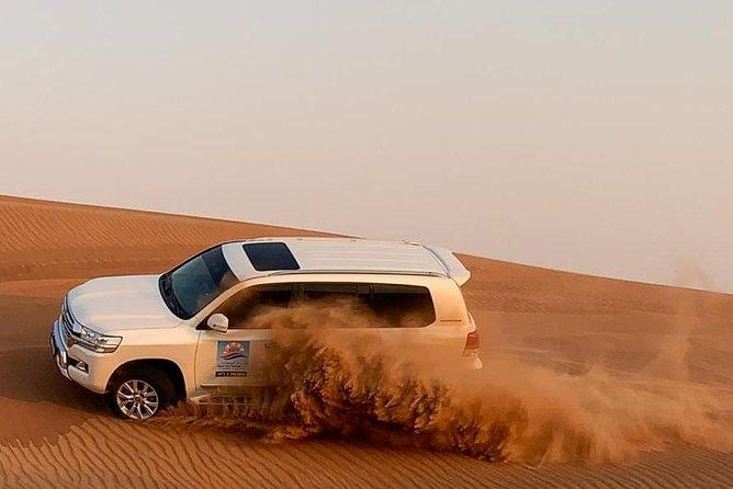 Private Evening Desert safari with BBQ Dinner, Camel Ride, Sand Boarding